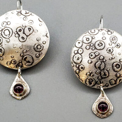 Judith Giusto - Round Silver Etched Disk, Silver Pear Shaped Garnet Dangle